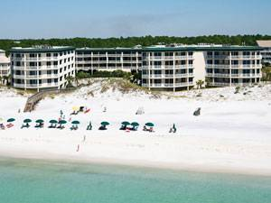 This view shows the Dunes of Seagrove condominiums, the brilliant white sand beach, and beautiful blue-green water of the Gulf of Mexico in Seagrove Beach, Florida.